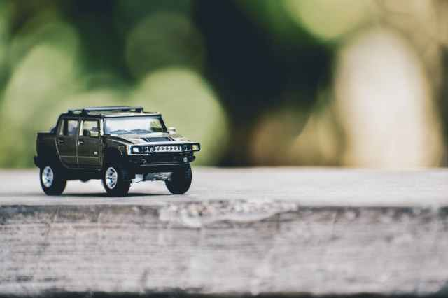 selective focus photography of gray hummer truck miniature